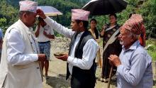 टिका तथा प्रसाद ग्रहन गर्नुहुदै अध्यक्ष श्री राम कृष्ण थापा ज्यू